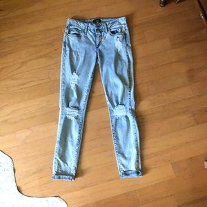 Bebe light acid destroy skinny jeans , size 27,